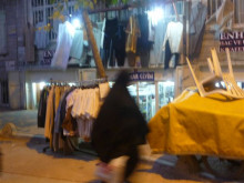 A woman rushes home before prayers infront of a different set of macks